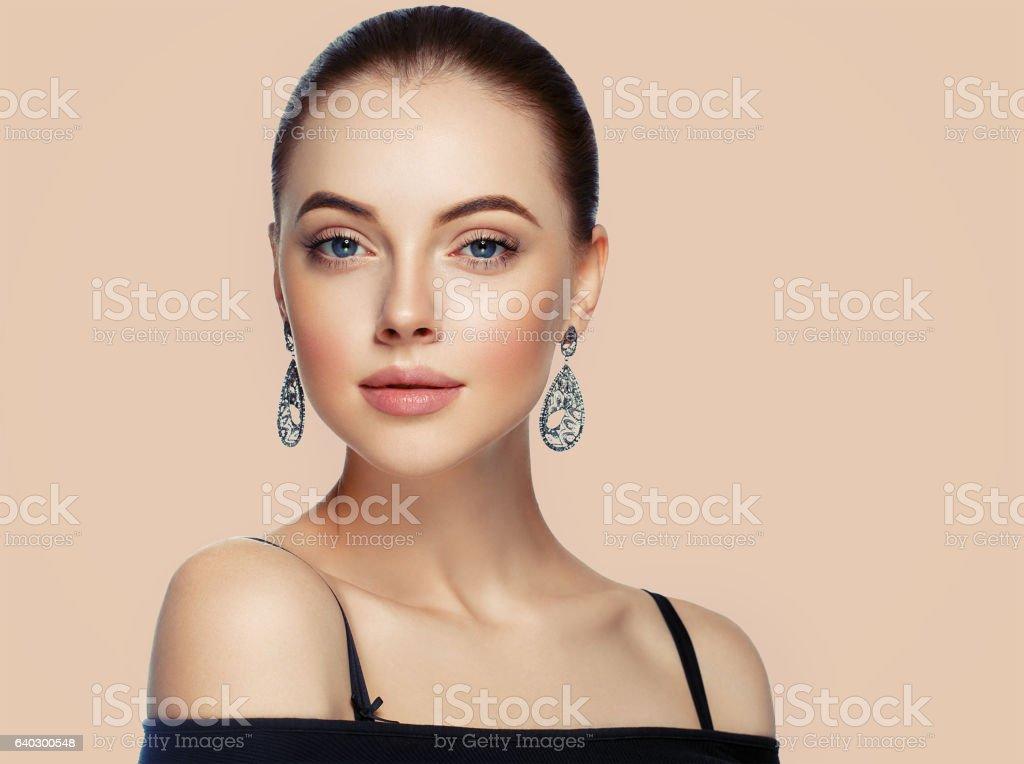 Beautiful Woman Portrait with Fashion Model jewelry. stock photo