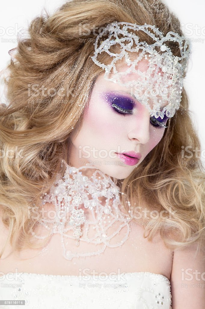 Beautiful woman portrait with pink lips. Snow queen stock photo