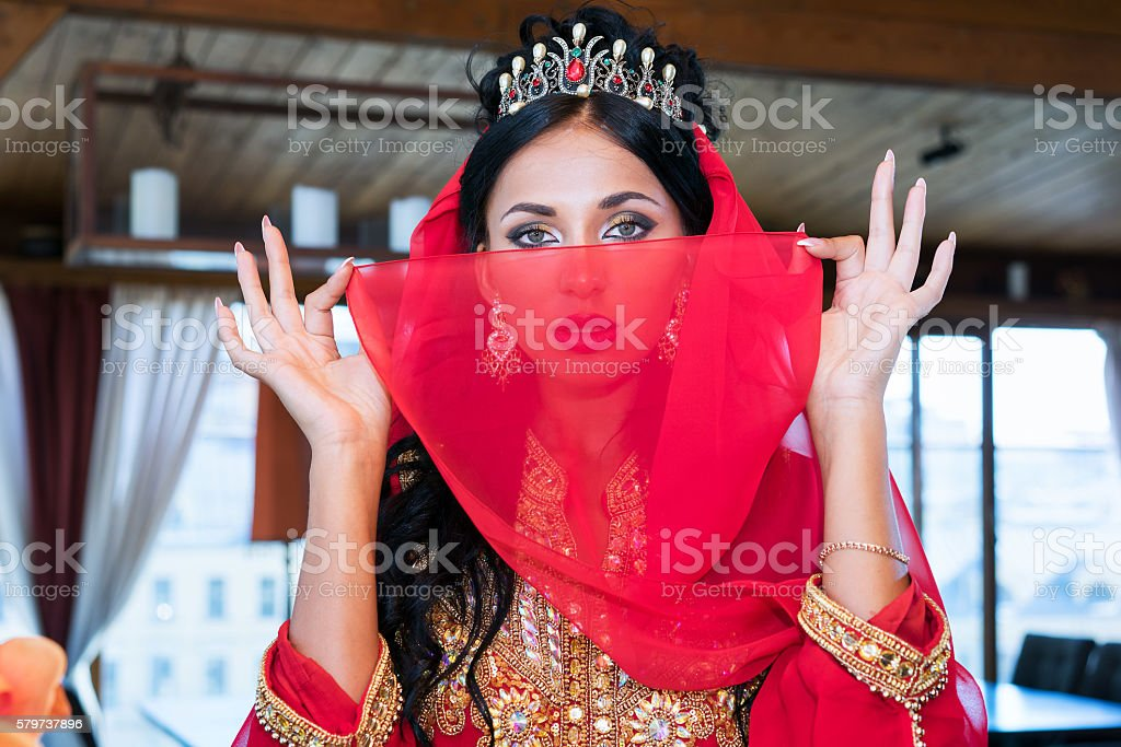 beautiful woman portrait with red veil over her head stock photo