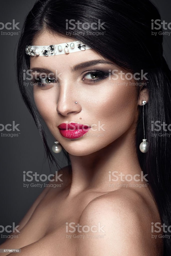 Beautiful woman portrait. Young lady posing closeup on dark background. stock photo