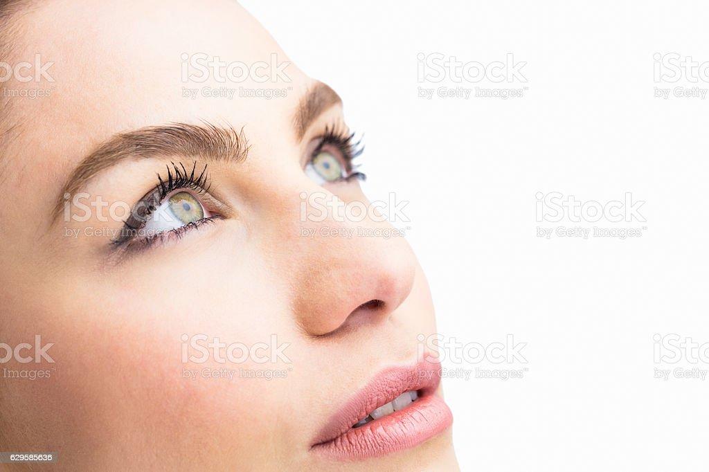 Beautiful woman posing against white background stock photo