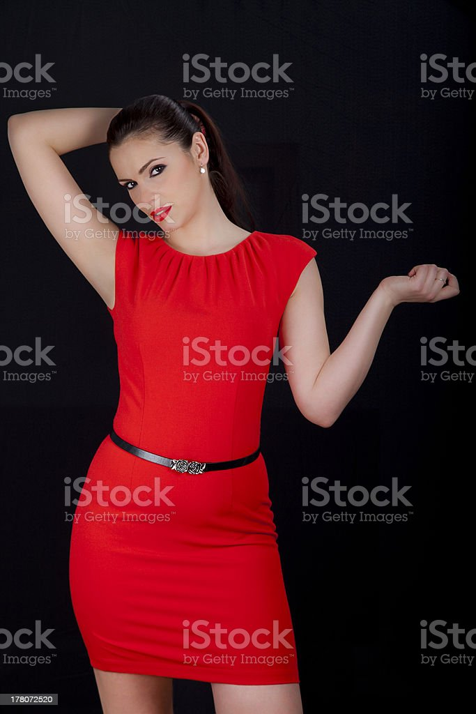 Beautiful woman posing in red dress royalty-free stock photo