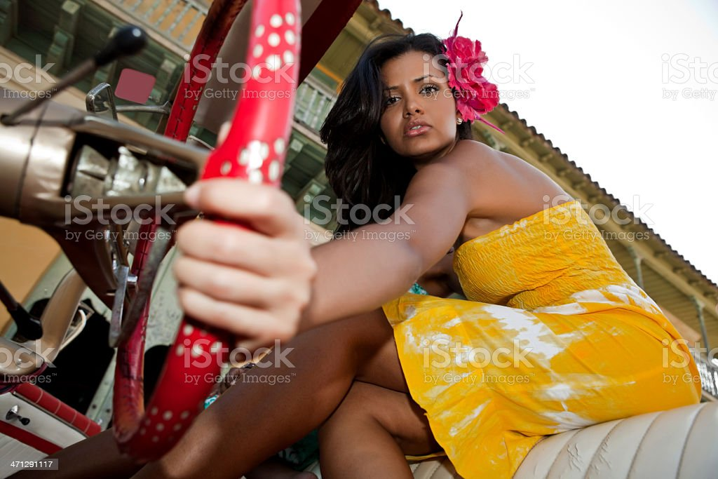 Beautiful woman posing with a red car royalty-free stock photo