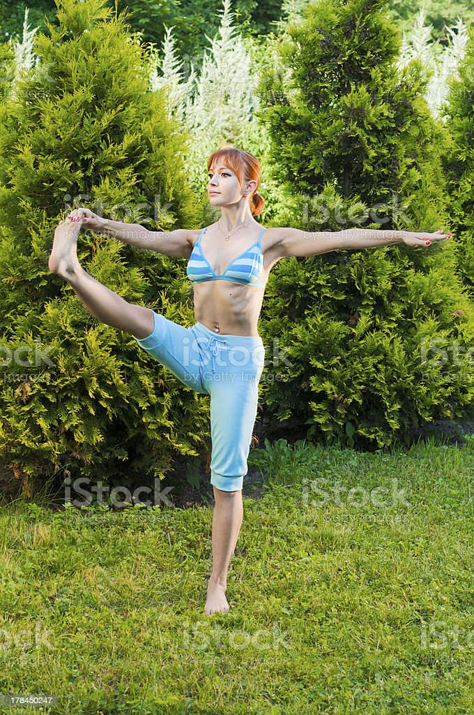 Beautiful woman practicing fitness or yoga stock photo