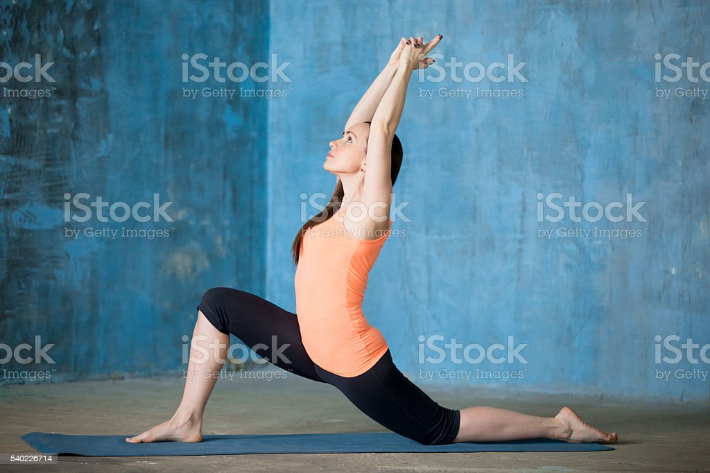 Beautiful woman practicing low lunge exercise stock photo