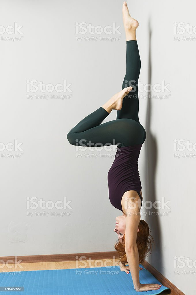 Beautiful woman practicing yoga asana stock photo