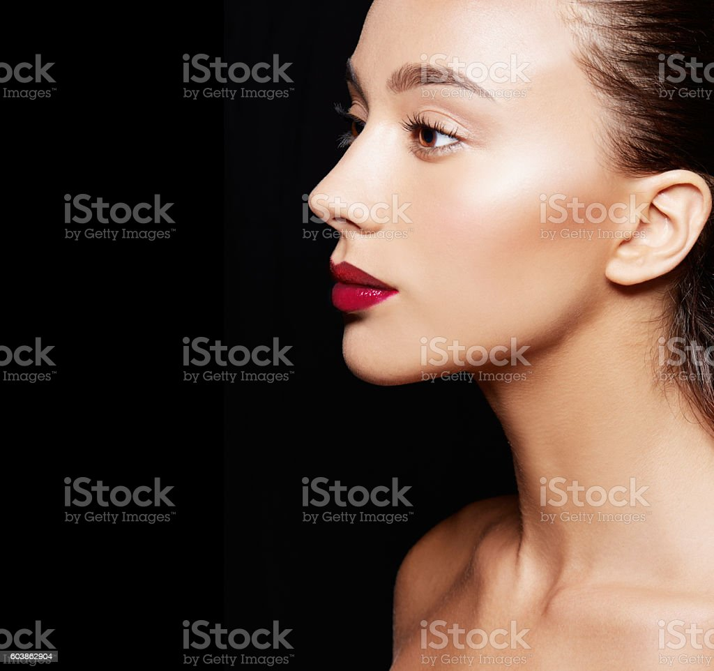 Beautiful woman profile isolated on black background. Cosmetic makeup image. stock photo
