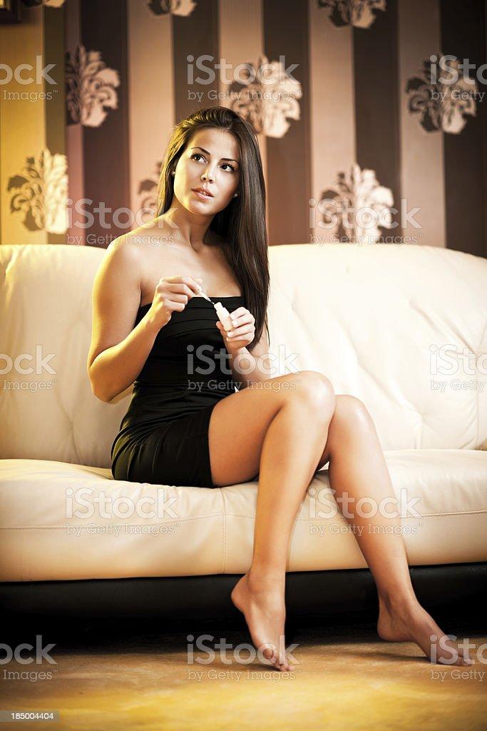 Beautiful woman putting on nail polish. royalty-free stock photo