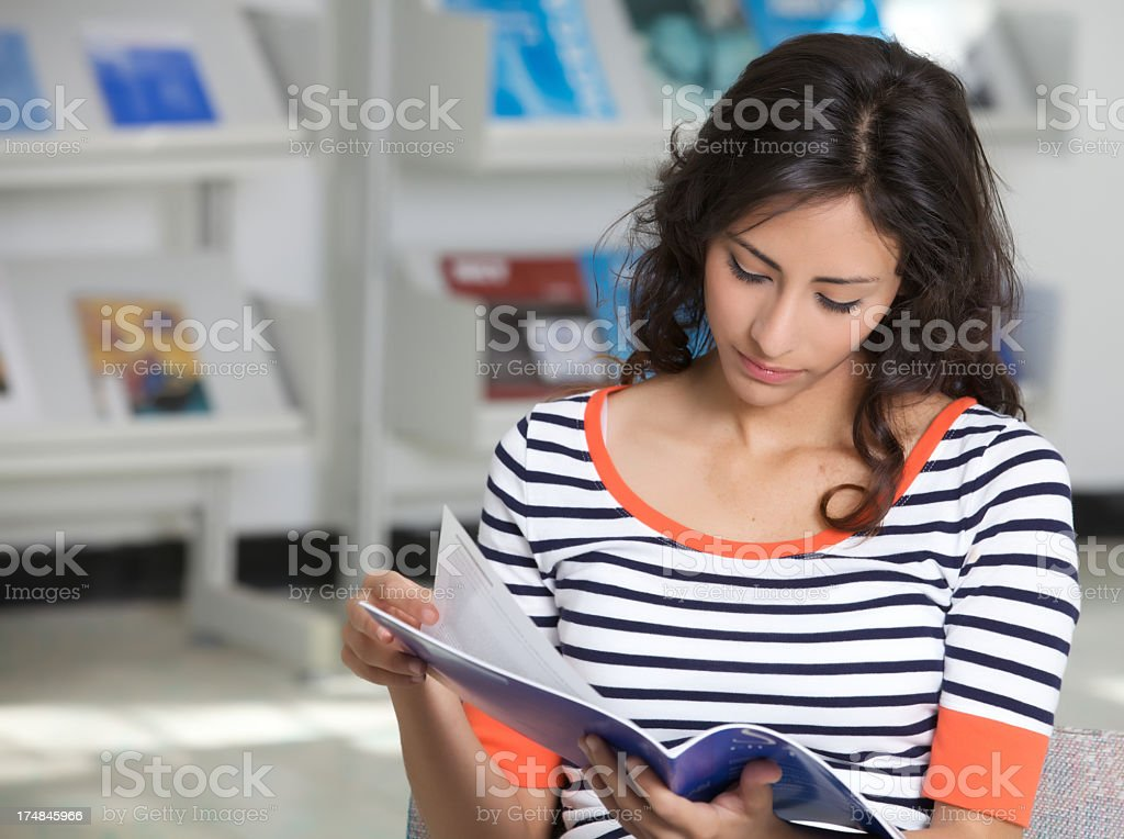 Beautiful woman reading a magazine royalty-free stock photo