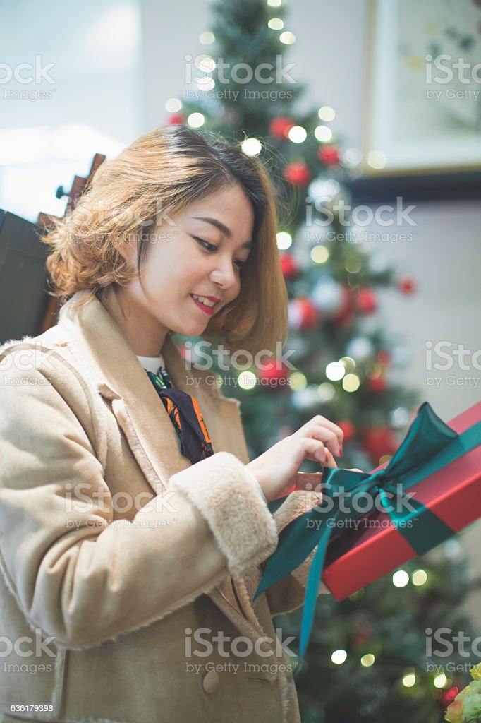 Beautiful woman ready to open christmas gifts stock photo