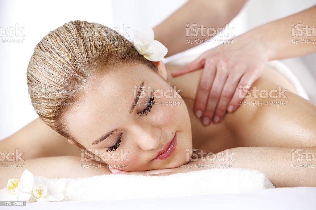 Beautiful woman receiving back massage at spa royalty-free stock photo