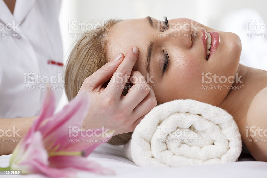 Beautiful woman receiving head massage at spa royalty-free stock photo