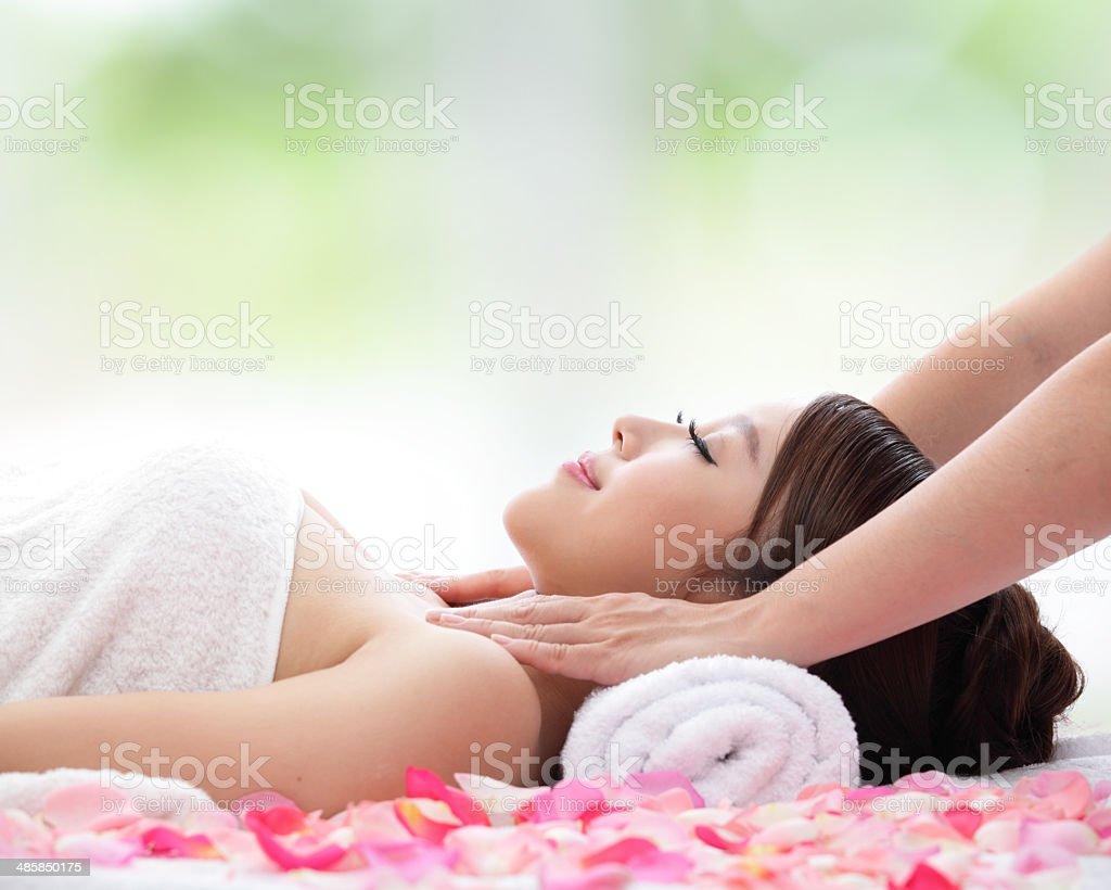 beautiful woman receiving massage stock photo