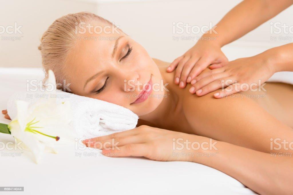 Beautiful woman receiving spa massage stock photo