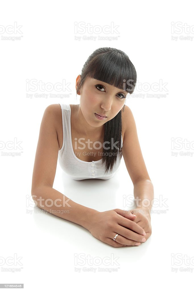 Beautiful woman relaxes on floor royalty-free stock photo