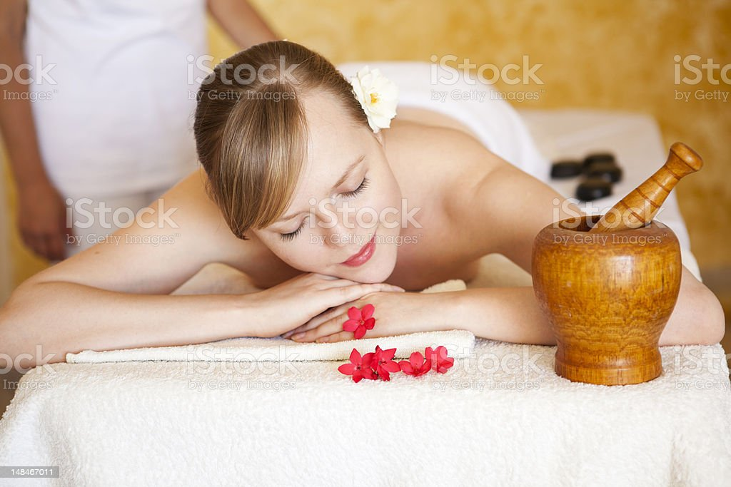 beautiful woman relaxing and receiving massage royalty-free stock photo
