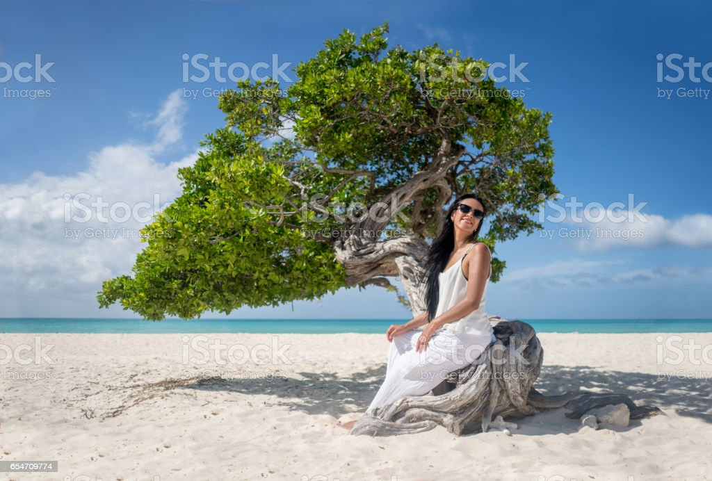 Beautiful woman relaxing at the beach stock photo