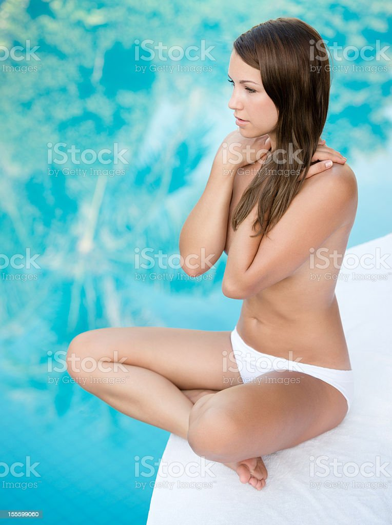 Beautiful Woman relaxing at the Pool (XXXL) royalty-free stock photo