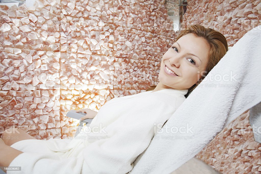 Beautiful woman relaxing in salt room. stock photo