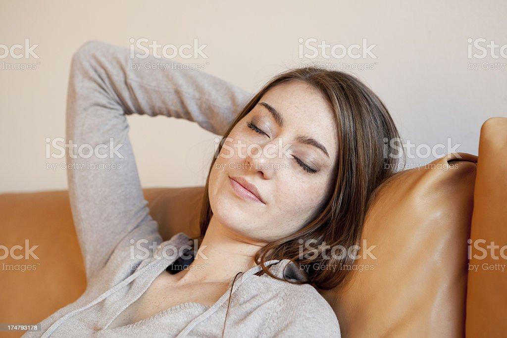 Beautiful woman relaxing on sofa royalty-free stock photo