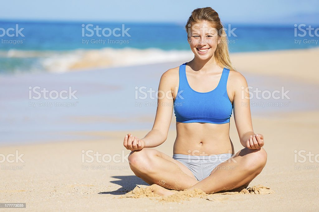 beautiful woman relaxing on the beach in Hawaii stock photo