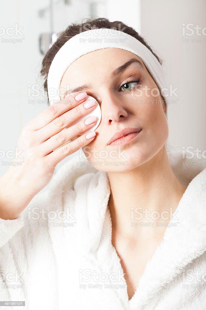 Beautiful woman removing make-up stock photo