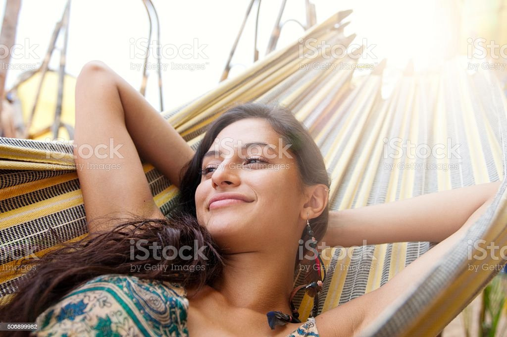 Beautiful woman resting on hammock stock photo