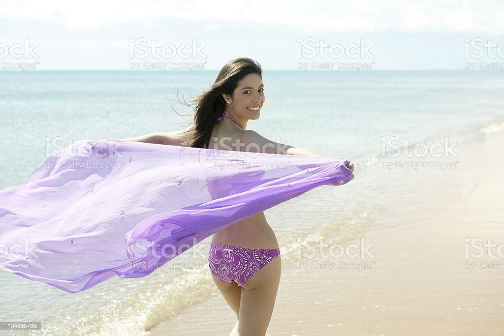 beautiful woman running in bikini on the beach royalty-free stock photo