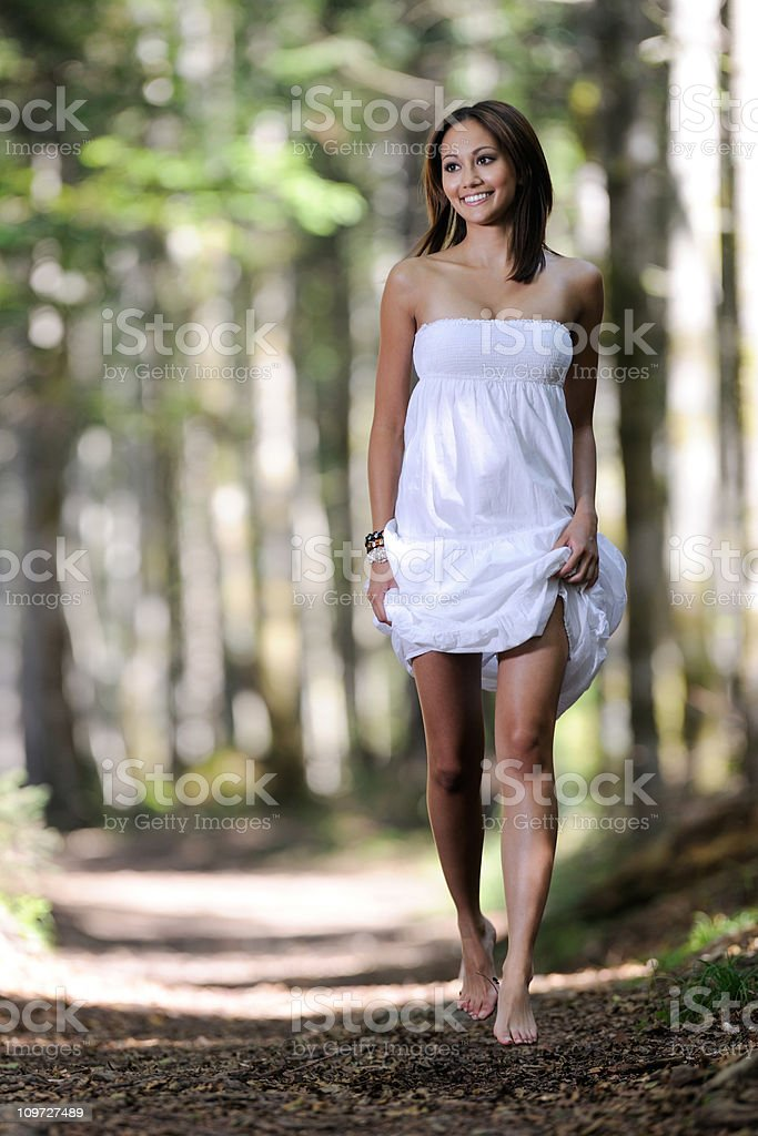Beautiful Woman running through an Enchanted Forest (XXXL) royalty-free stock photo