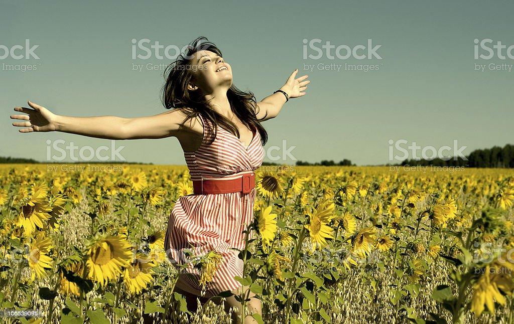 beautiful woman  runs on a glade stock photo