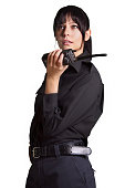 Beautiful woman security Police Officer Holding a Walkie-talkie black background