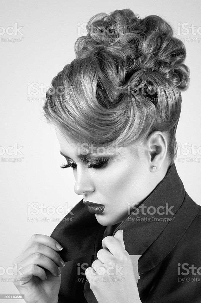 Beautiful woman sets the collar straight stock photo
