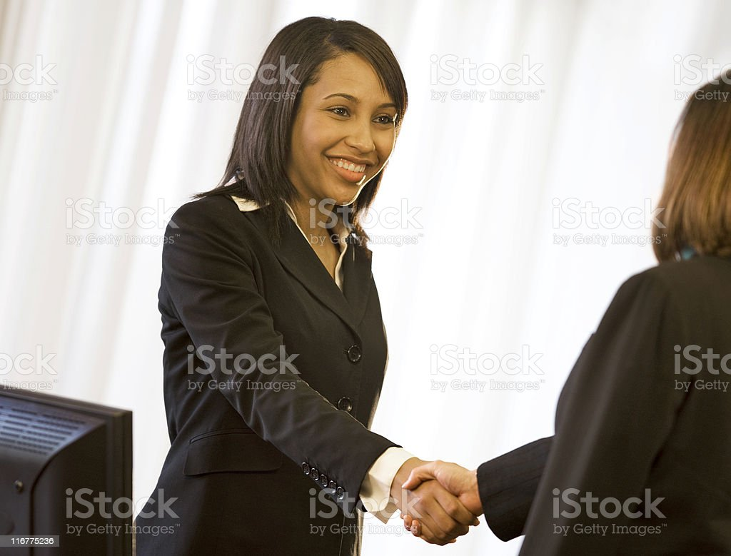Beautiful Woman Shaking Hands royalty-free stock photo