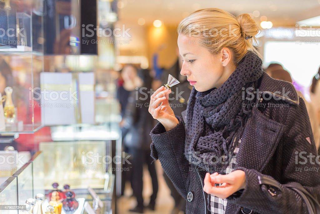 Beautiful woman shopping in beauty store. stock photo