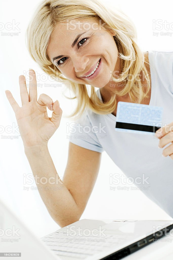 Beautiful woman shopping over the internet royalty-free stock photo
