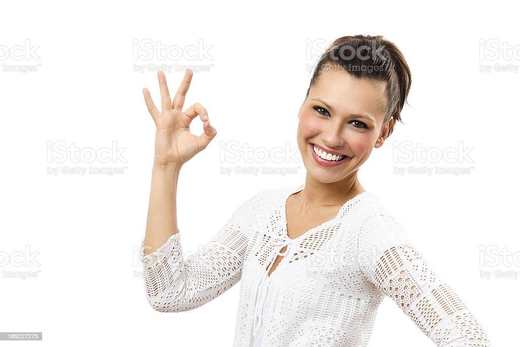 Beautiful woman showing an OK sign stock photo