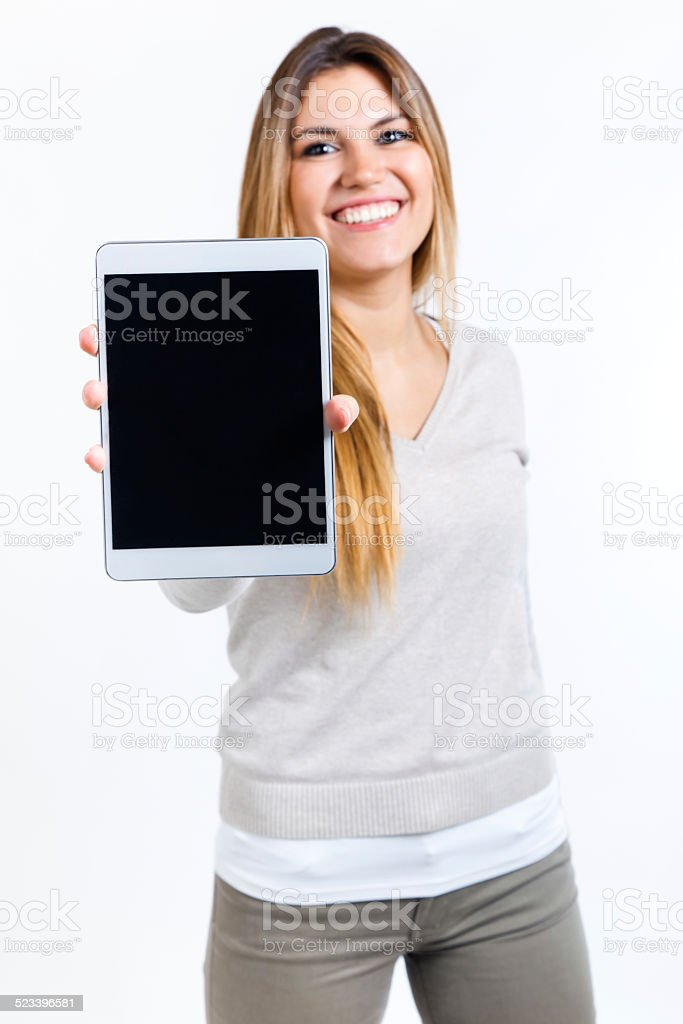 Beautiful woman showing digital tablet. Isolated on white. stock photo