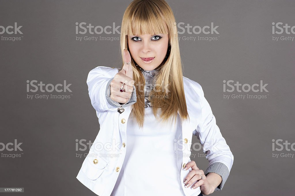 beautiful woman showing thumbs up royalty-free stock photo