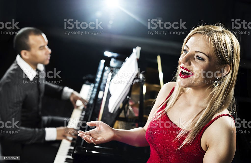Beautiful woman singing. royalty-free stock photo