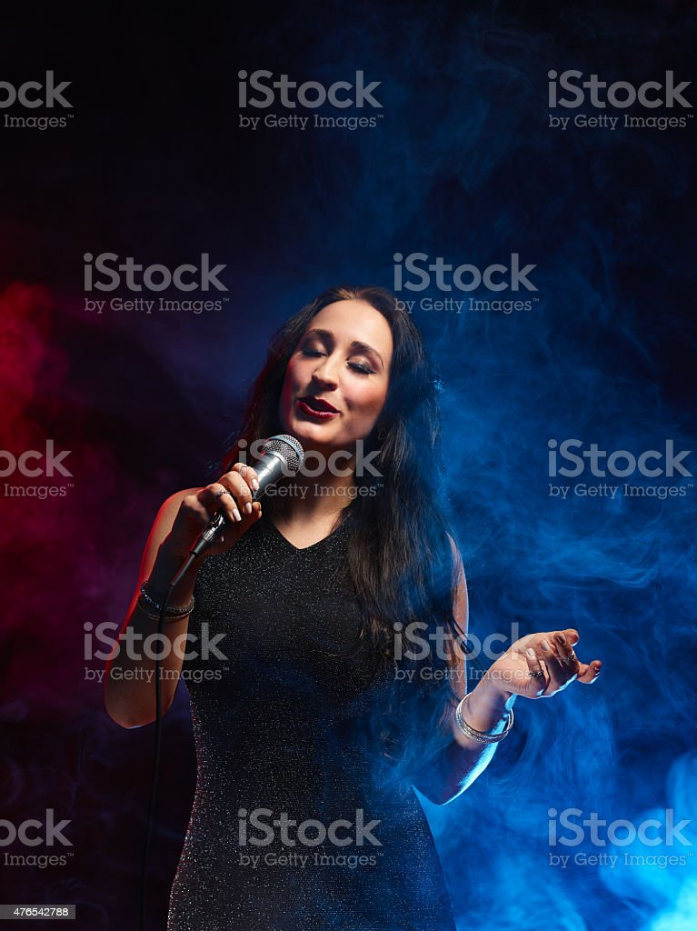 Beautiful woman sings stock photo