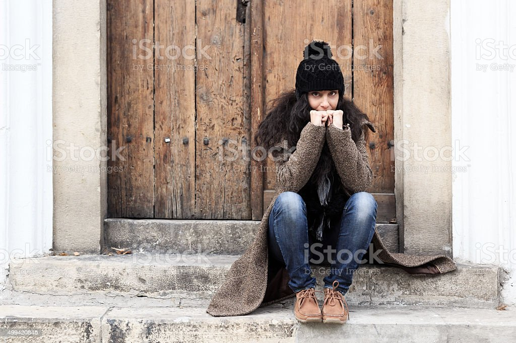 Beautiful woman sitting at the stairs outdoor stock photo