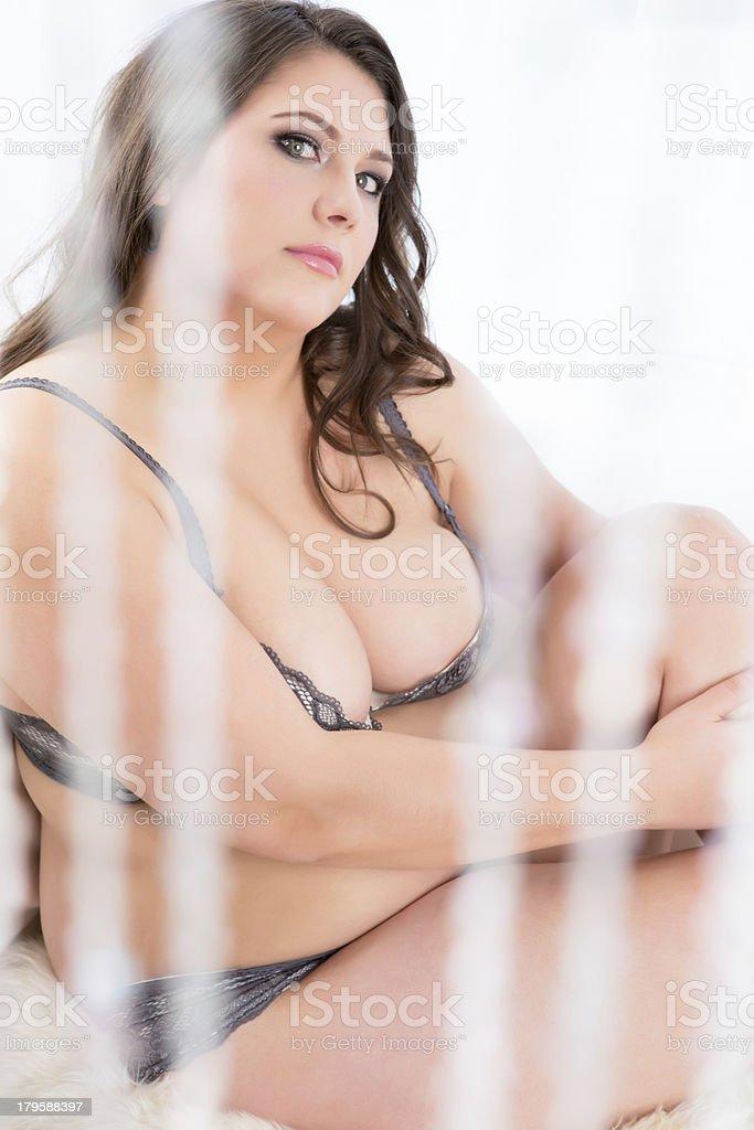 Beautiful woman sitting behind crystal curtain royalty-free stock photo