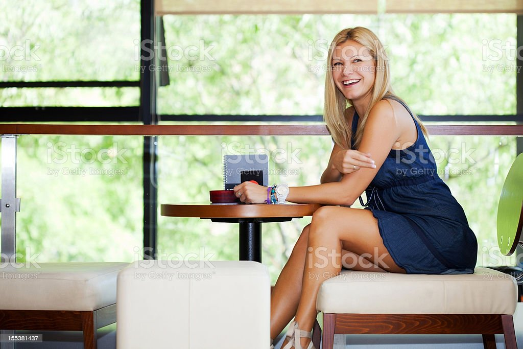 Beautiful woman sitting in cafe. royalty-free stock photo