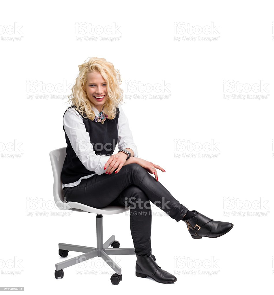 Beautiful woman sitting in chair and smiling stock photo