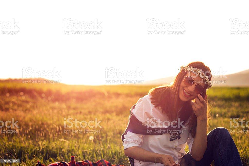Beautiful Woman Sitting in Field stock photo