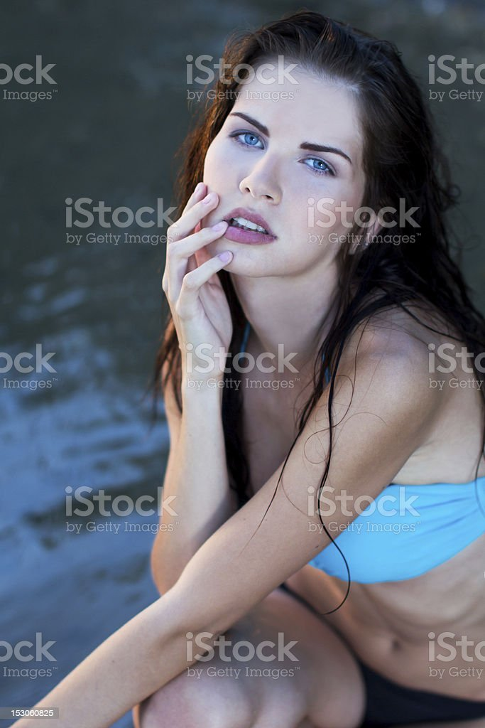 Beautiful woman sitting in the water royalty-free stock photo