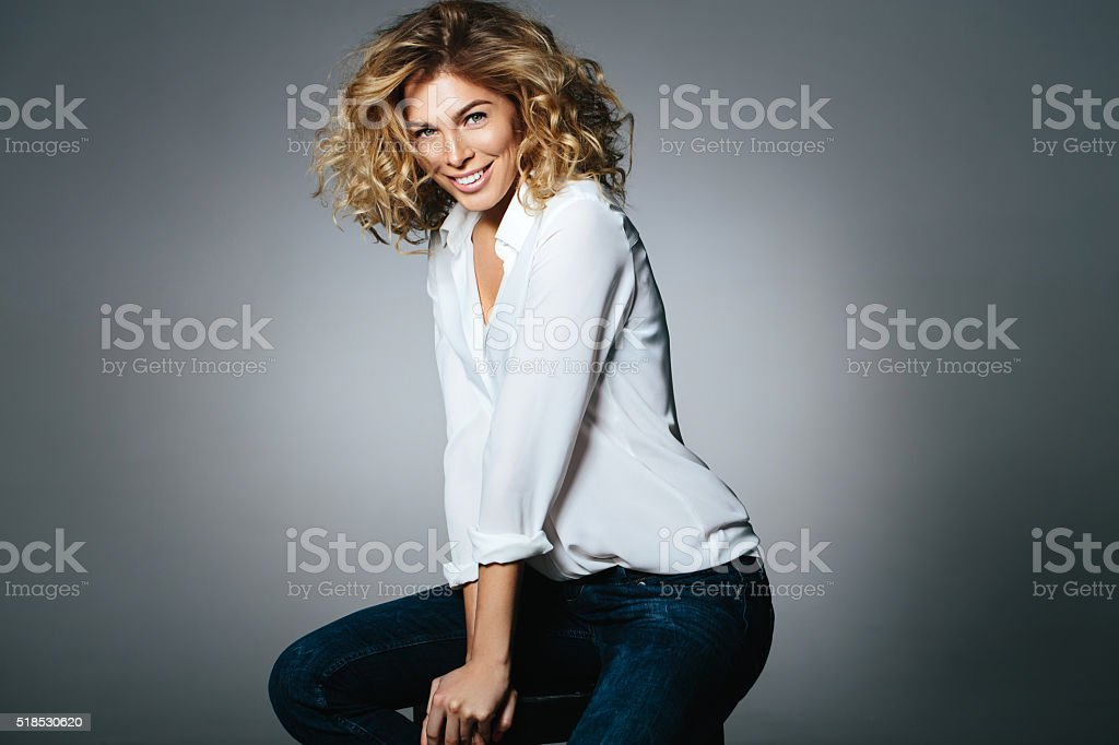 Beautiful woman sitting on a chair stock photo