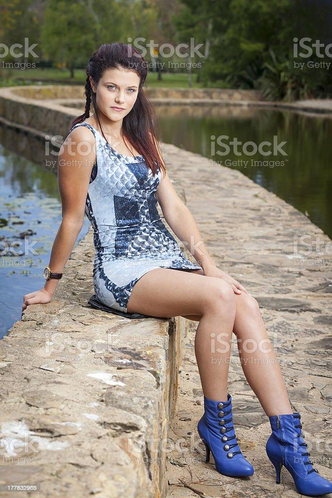 Beautiful Woman sitting on curve wall royalty-free stock photo