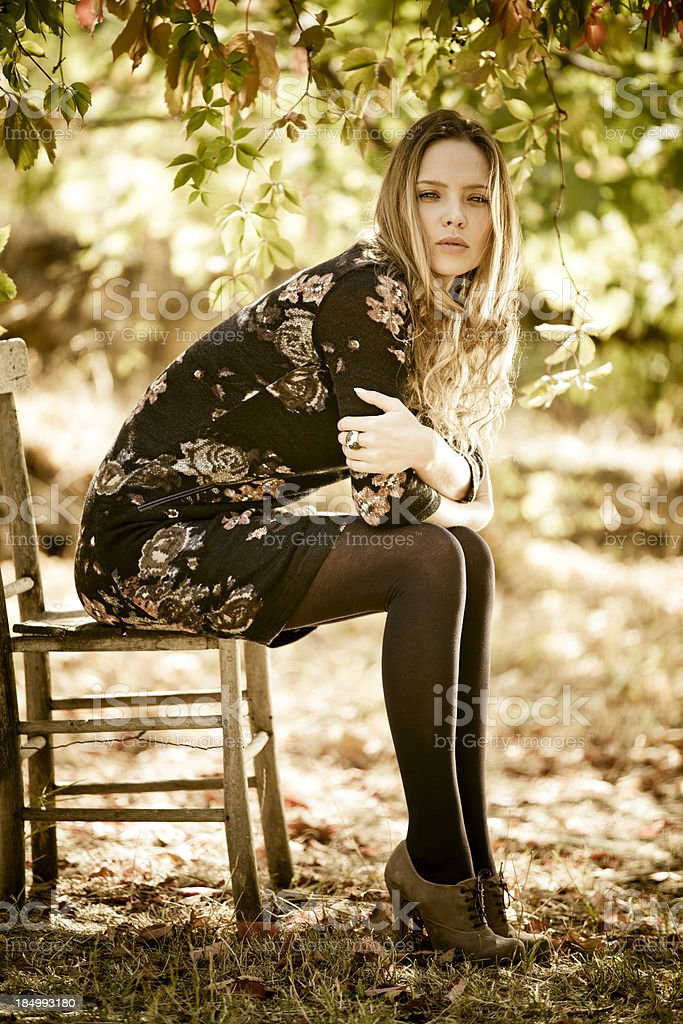 Beautiful woman sitting on old chair royalty-free stock photo