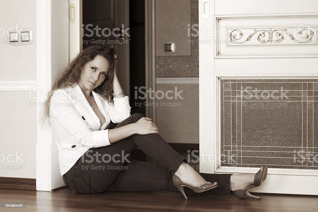 Beautiful woman sitting on the floor royalty-free stock photo
